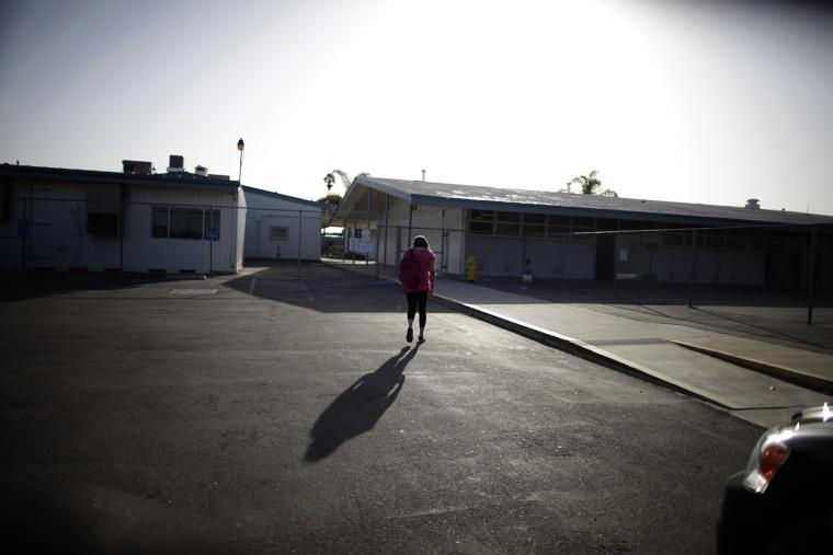 Melinda Guzman, 12, walks into her school in Port Hueneme, some 65 miles northwest of Los Angeles, California on Feb. 28, 2012.