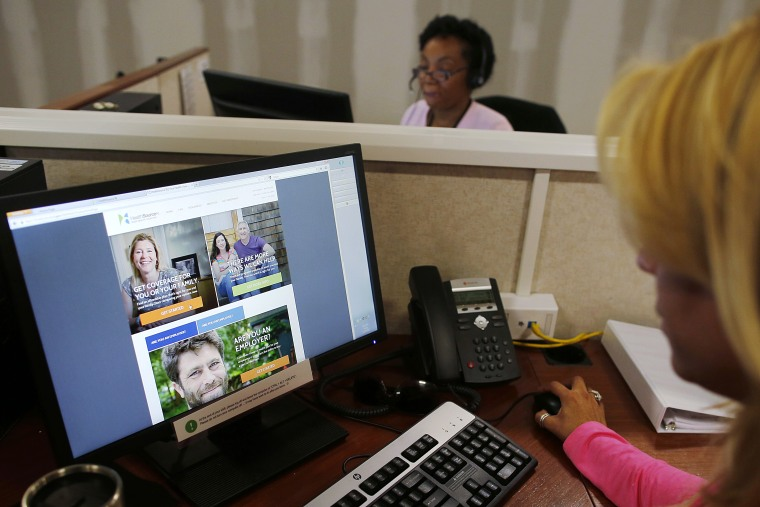 Janet Perez oversees specialists help callers with health insurance, at a customer care center in Providence, Rhode Island