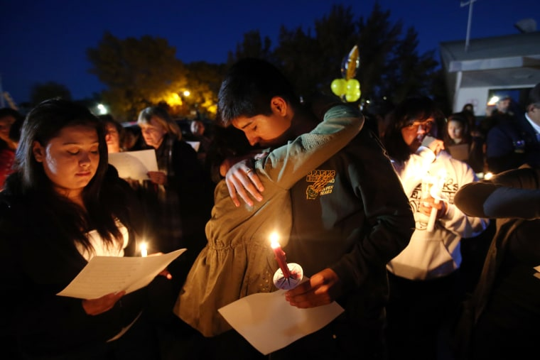 Hundreds of students and residents attend a candlelight vigil at Sparks Middle School in Sparks, Nev., on Wednesday, Oct. 23, 2013,