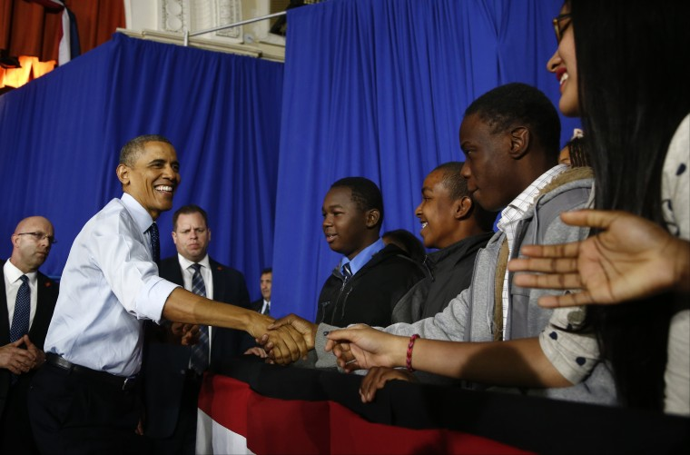 President Barack Obama greets students during his visit to Pathways in Technology Early College High School (P-TECH) in Brooklyn borough of New York, Friday, Oct. 25, 2013
