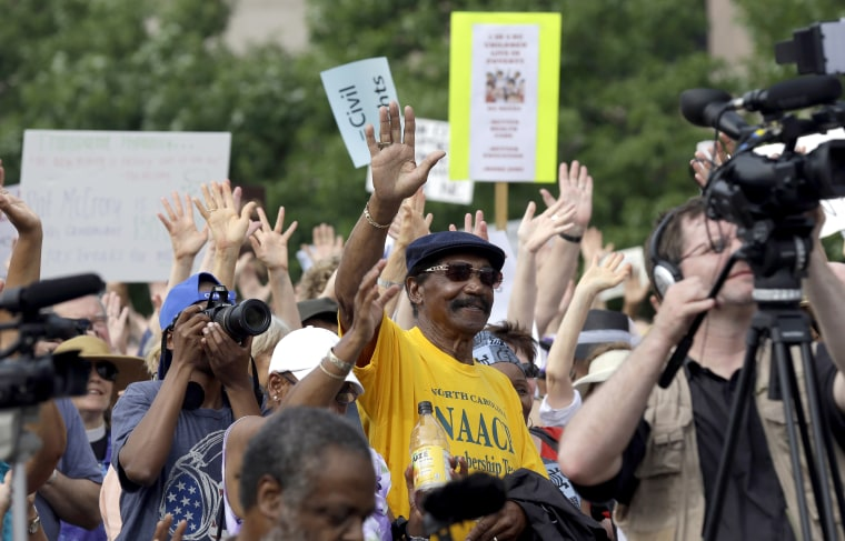 """Demonstrators and NAACP-led supporters opposing the Republican legislature's agenda congregate at Halifax Mall during """"Moral Monday"""" protests at the General Assembly in Raleigh, N.C., Monday, June 24, 2013."""