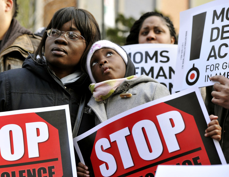 Demonstrators attend a rally and march to support federal and state gun control proposals on March 21, 2013 in the Harlem district of New York City.