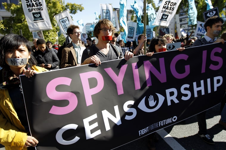 Demonstrators March through Washington towards the National Mall to rally and demand that the U.S. Congress investigate the National Security Agency's mass surveillance programs Saturday, Oct. 26, 2013.