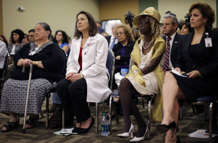 Audience members listen to Health and Human Services Secretary Kathleen Sebelius