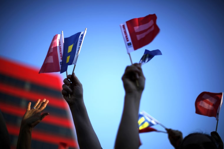 People wave marriage equality flags in West Hollywood, after the United States Supreme Court ruled on California's Proposition 8 and the federal DOMA