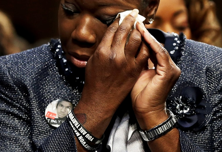 """Sybrina Fulton wipes her eyes during a Senate Judiciary Committee hearing on \""""Stand Your Ground\"""" laws October 29, 2013 in Washington, DC."""