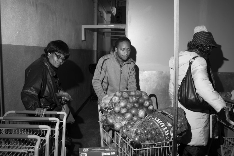 Paul Jones brings bags of onions to restock bins at the Bed-Stuy Campaign Against Hunger food pantry, in Brooklyn, New York.