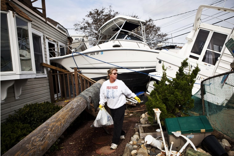 Regina Yahara-Splain cleans out her home after it was damaged by Superstorm Sandy on November 1, 2012 in Highlands, New Jersey.