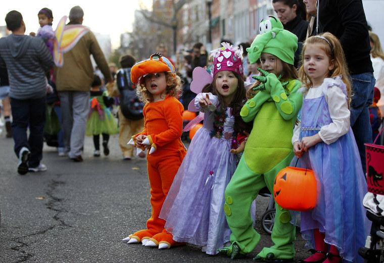 Children participate in the postponed annual Ragamuffin Halloween Parade in Hoboken