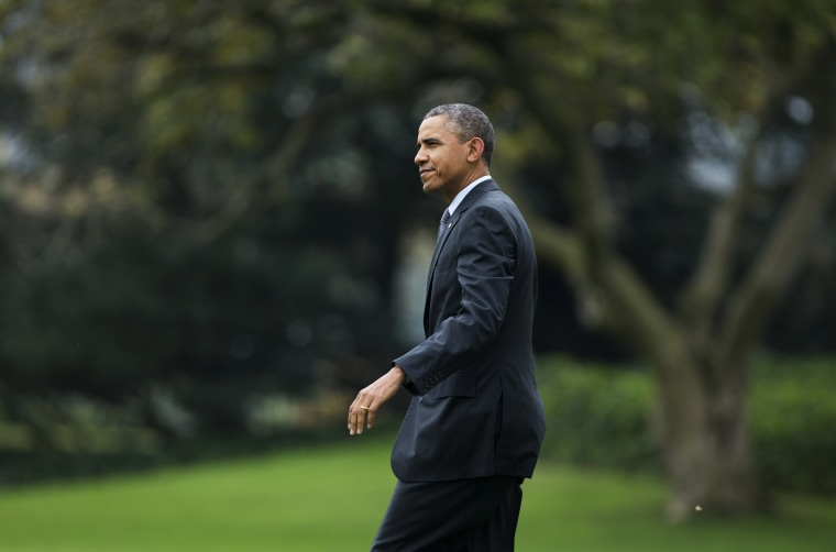 President Barack Obama walks on the South Lawn as he leaves the White House in Washington, Wednesday, Oct. 30, 2013, for a trip to Boston.