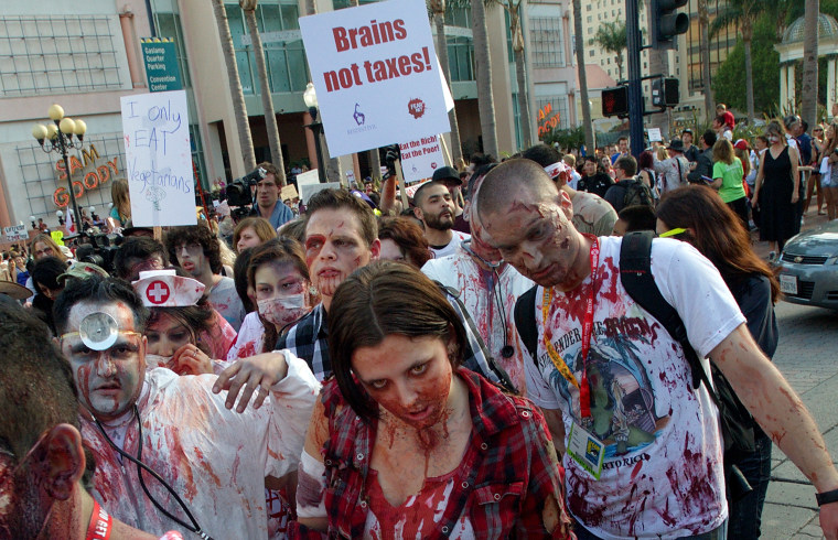 Fans participate in ''Zombie Walk: San Diego'' during Comic-Con International 2012 on July 13, 2012 in San Diego.