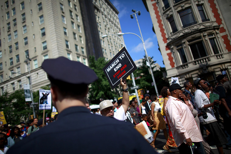 Demonstrators march during a protest in New York June 17, 2012.