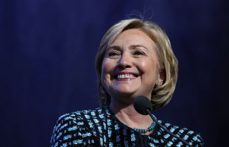 Hillary Clinton smiles as she introduces former U.S. President Bill Clinton and U.S. President Barack Obama to discuss healthcare reform at the Clinton Global Initiative in New York September 24, 2013.