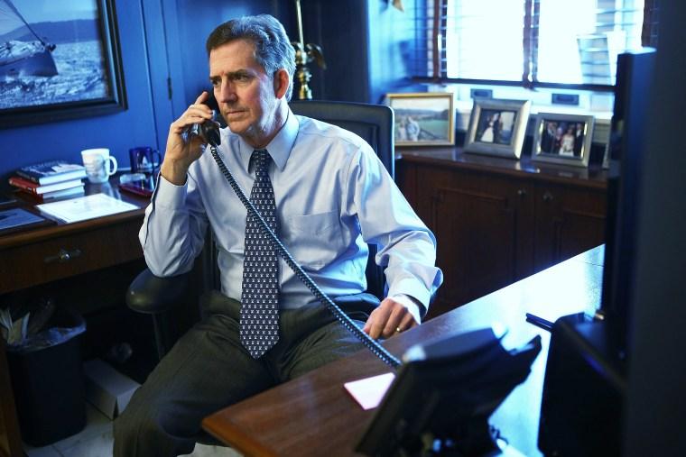 U.S. Senator Jim DeMint (R-SC) talks on the phone in his office December 6, 2012 on Capitol Hill in Washington, DC.