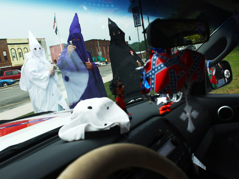 Members of the Fraternal White Knights of the Ku Klux Klan participate in the 11th Annual Nathan Bedford Forrest Birthday march July 11, 2009 in Pulaski, Tennessee.