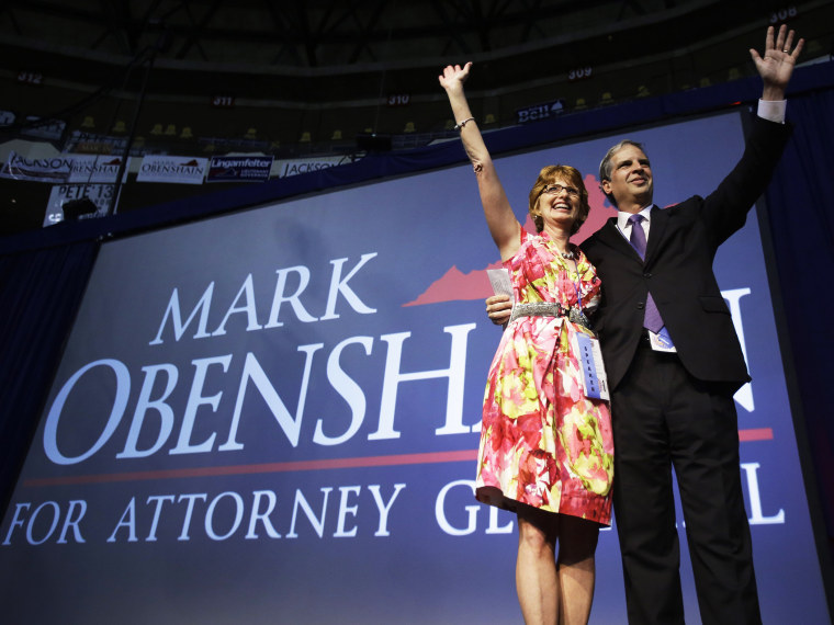 State Sen. Mark Obenshain waves to the crowd with his wife, Suzanne at the Virginia Republican convention, May 18, 2013.