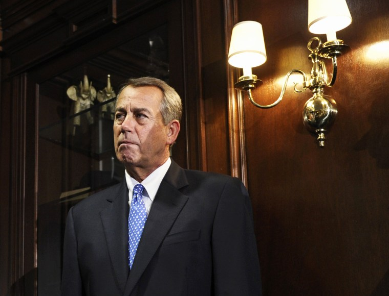 House Speaker John Boehner listens during a news conference at the Republican National Committee offices in Washington, Oct. 23, 2013.
