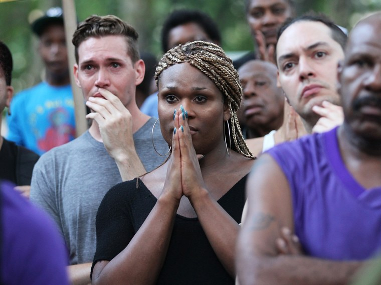 People gather at a vigil for transgender woman Islan Nettles at Jackie Robinson Park in Harlem on August 27, 2013 in New York City.