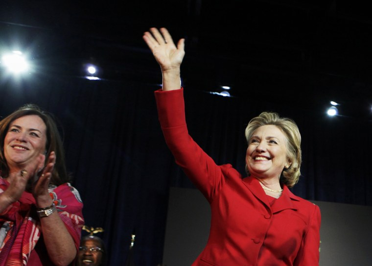 Hillary Clinton waves to the audience at an event to endorse Virginia gubernatorial candidate Terry McAuliffe at The State Theatre in Falls Church, Virginia, October 19, 2013.