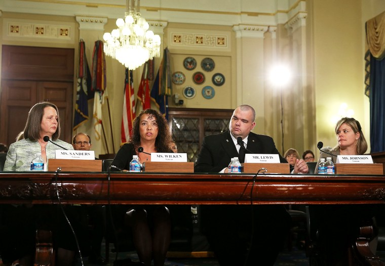 Military sexual assault survivors sit at the witness table while participating in a House Veteran Affairs Subcomittee on Capitol Hill, July 19, 2013 in Washington, DC.