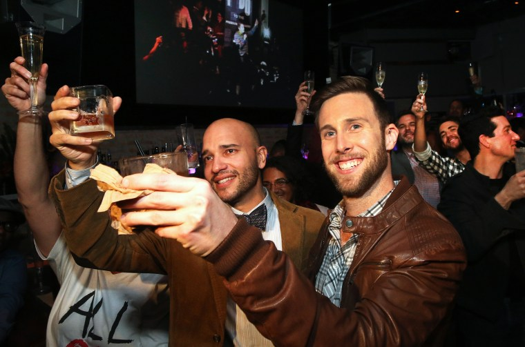 Fernando Mojica and  Drew Freeman raise a toast in celebration of the Illinois General Assembly's approval of a gay marriage bill on November 5, 2013 in Chicago, Illinois.