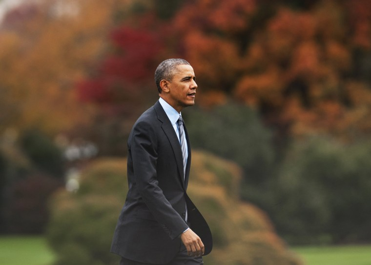 US President Barack Obama walks from Marine One after arriving at the White House, November 5, 2013.