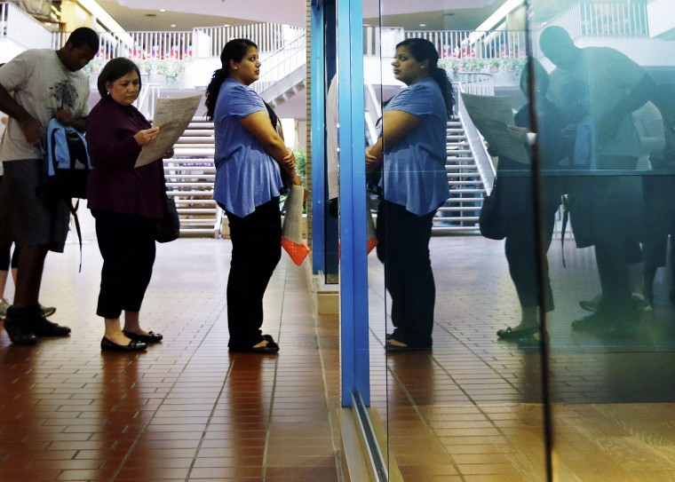 Voters wait in line at a polling place located inside a shopping mall, on Election Day, Tuesday, Nov. 6, 2012, in Austin, Texas