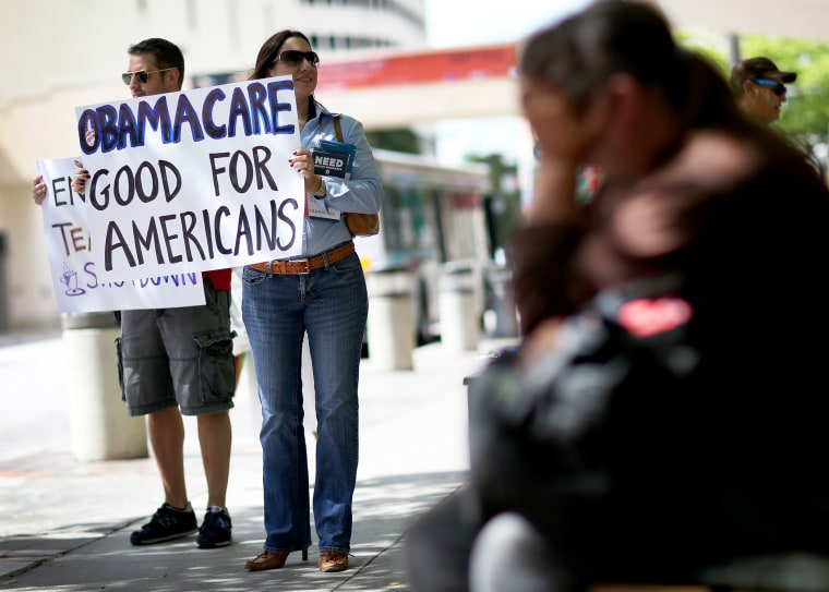 Haydee Perkal shows her support for the Affordable Care Act during a rally, October 10, 2013 in Miami, Florida.