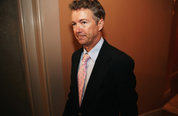 Sen. Rand Paul leaves a Republican Senate caucus meeting, September 30, 2013 in Washington, DC.