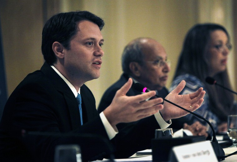 Senator Jason Carter, left, talks during a press conference for the Carter Center's election witnessing mission in Egypt, in Cairo, Egypt, Tuesday, June 19, 2012.