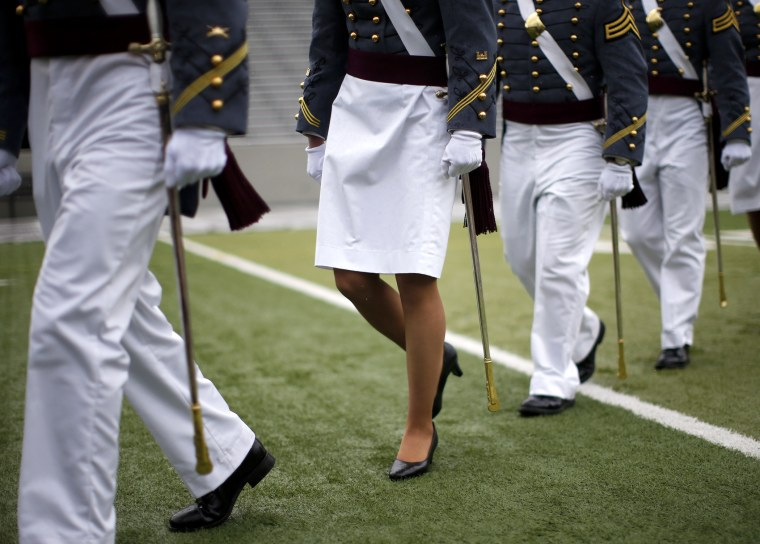 A female cadet marches with other cadets for their graduation ceremony on May 24, 2013.