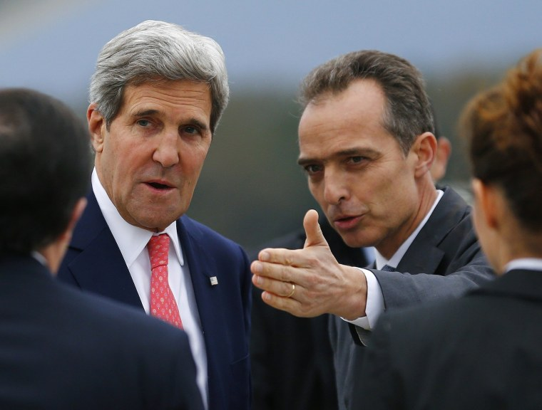 Jean-Luc Chopard, Geneva head of Protocol, right, welcomes US Secretary of State John Kerry, left, at his arrival for closed-door nuclear talks at the United Nations offices in Geneva, Switzerland, Friday, Nov. 8, 2013.