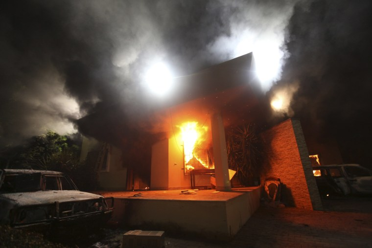 The U.S. Consulate in Benghazi is seen in flames during a protest by an armed group in this file photo taken September 11, 2012.