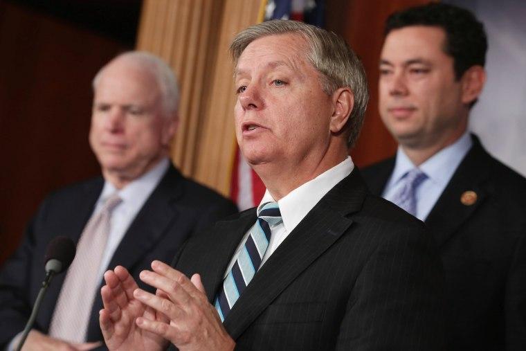 Image: Graham, McCain, GOP Senators Hold News Conference On Benghazi