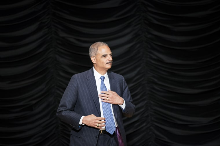 US Attorney General Eric Holder Jr. arives to speak at a ceremony at the Ronald Reagan Building September 6, 2013 in Washington, DC.