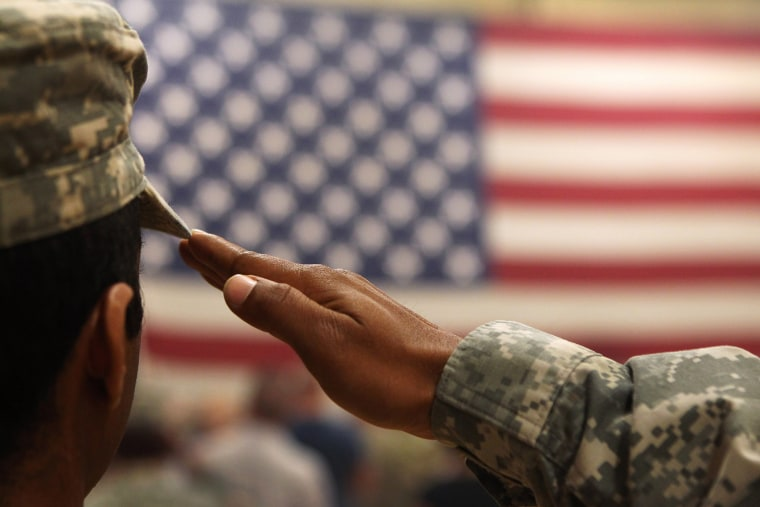 A soldier salutes the flag during a welcome home ceremony for troops arriving from Afghanistan on June 15, 2011 to Fort Carson, Colorado.