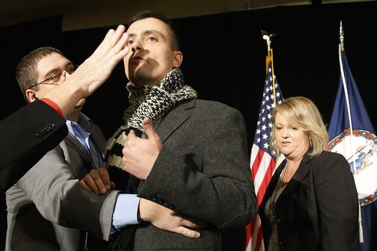 A protester calling for immigration reform is removed from the stage at the election night event for Virginia Republican gubernatorial nominee Ken Cuccinelli in Richmond, Virginia, November 5, 2013.