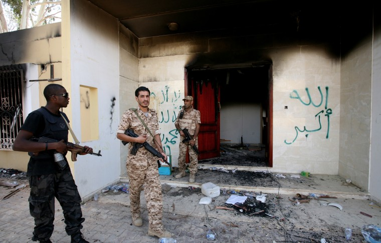 In this Sept. 14, 2012 file photo, Libyan military guards check one of the U.S. Consulate's burnt out buildings.