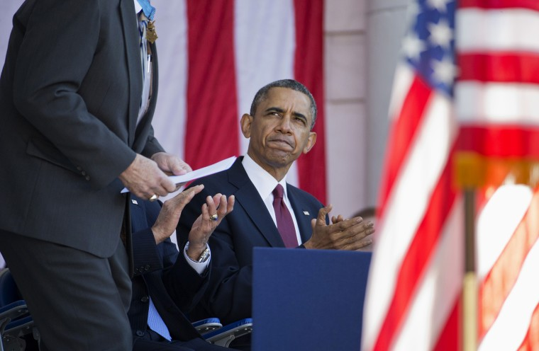 President Barack Obama applauds as Harold Fritz, president of the Congressional Honor Society