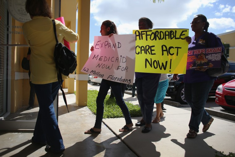 Activists Demonstrate In Support Of Medicaid Expansion And The Affordable Care Act in Miami, Florida, September 20, 2013.