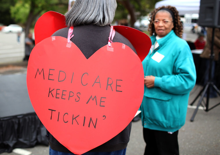 A senior citizen holds a sign during a rally to protect federal health programs at the 8th Annual Healthy Living Festival on July 15, 2011 in Oakland, California.