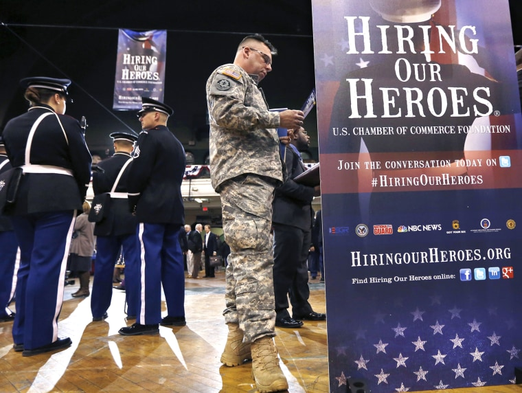 Current and former members of the military attend the 'Hiring Our Heroes' job fair in New York, March 27, 2013.