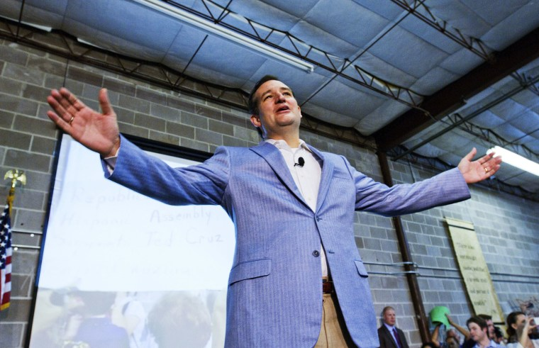U.S. Senator Ted Cruz gestures on stage as he is welcomed home by supporters in Houston, October 21, 2013.
