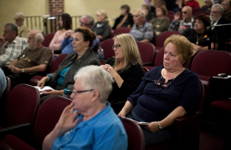 Audience members listen during a federal health care law informational town hall meeting with Rep. Matt Cartwright, D-Pa., Nov. 1, 2013, in Pottsville, Pa.