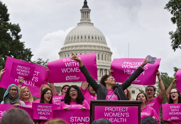 Women rally on Capitol Hill in Washington, Thursday, July 11, 2013.
