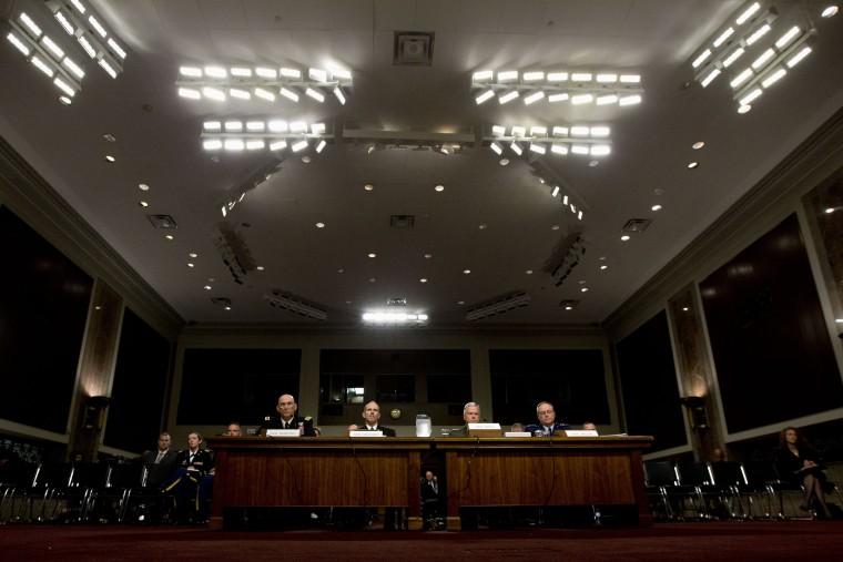 Pentagon officials are seen on Capitol Hill in Washington, Thursday, Nov. 7, 2013.