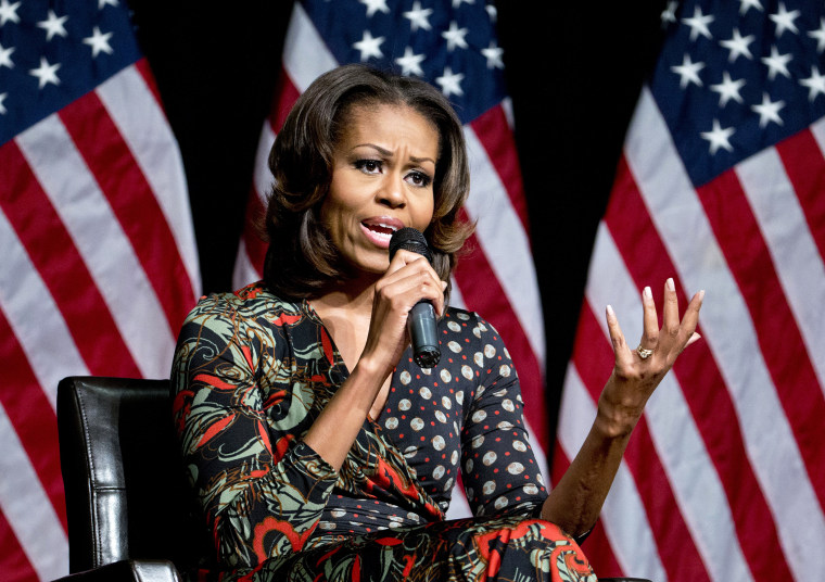 First lady Michelle Obama speaks to students about committing to education, Tuesday, Nov. 12, 2013, at Bell Multicultural High School in Washington.