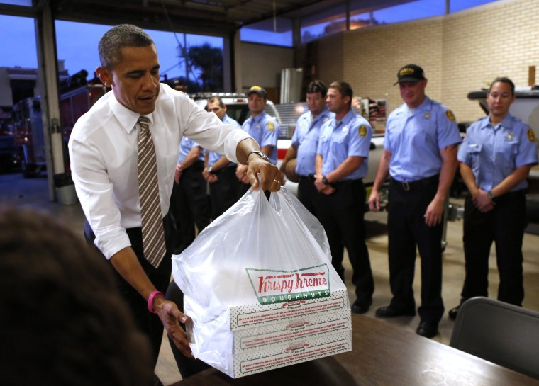 U.S. President Barack Obama delivers doughnuts to fire fighters at a fire house in Tampa, Florida October 25, 2012. Note to Rand Paul: He's dropping off, not confiscating.