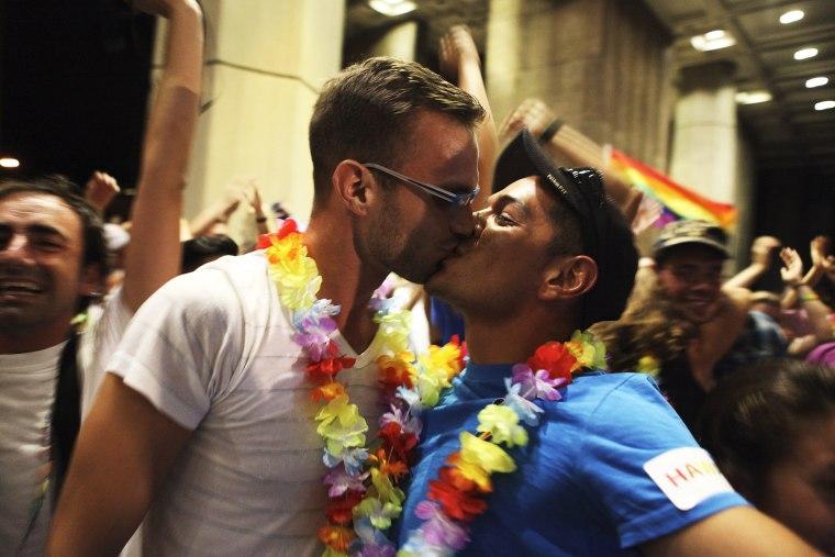 Jon Raffesberger and his partner German Sanchez celebrate after the Hawaii State Legislature voted on allowing same sex marriage in Honolulu, HI, November 8, 2013.
