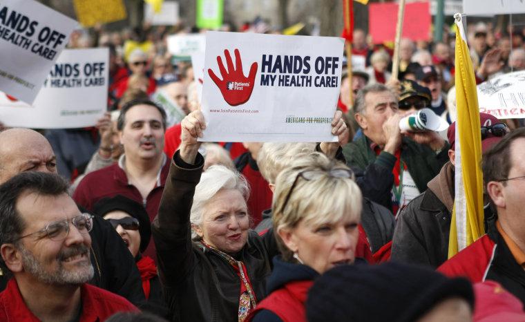 Image: Demonstrators protest healthcare legislation at the Capitol in Washington